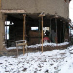 Rebuilding the west wall of Abrazo House - this time using solid cob.