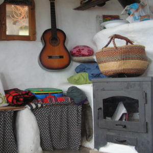 The interior of the cabin showing the woodstove.
